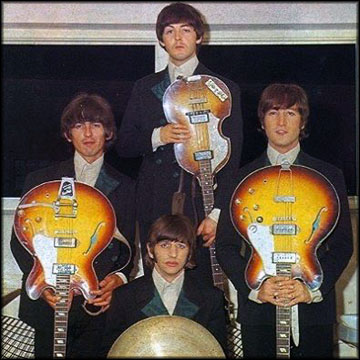 The Beatles with Upside-Down Guitars