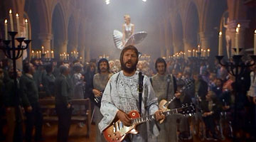 Eric Clapton as ''The Preacher,'' leader of the Marilyn Monroe cult in the movie ''Tommy'' (1975).
