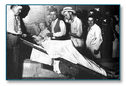 Even in death, the Dillinger mystique was attributed with another larger-than-life quality when a post-mortem photograph suggested that he had an extraordinarily large penis. However, the official explanation for the anomaly is that, under the shrouding sheet, one of Dillinger's arms was locked into the suggestive position due to rigor mortis. So this ''gun,'' too, while not being made of carved wood and shoe polish, was yet just another illusion.